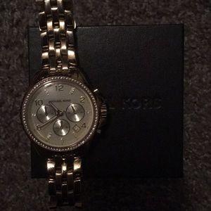 woman's michael kors gold watch
